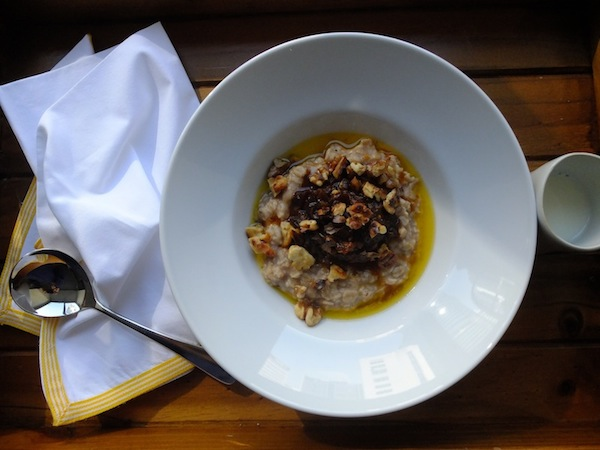 PORRIDGE WITH EARL GREY STEWED PRUNES, TOASTED WALNUTS, AND MELTED BUTTER