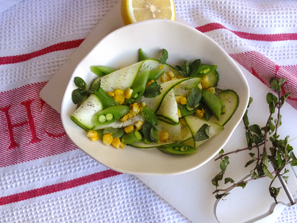 A ZUCCHINI, MINT, SUGAR SNAP, AND ROASTED CORN SALAD